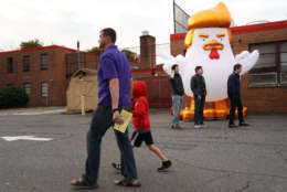 ALEXANDRIA, VA - NOVEMBER 07:  Supporters of Democrat Ralph Northam inflate a cartoon chicken made to resemble President Donald Trump outside the polling place at Washington Mill Elementary School November 7, 2017 in Alexandria, Virginia. (Photo by Chip Somodevilla/Getty Images)