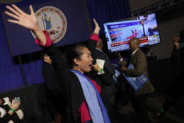 FAIRFAX, VA - NOVEMBER 07:  Hyun Lee, a supporter of Ralph Northam, the Democratic candidate for governor of Virginia, celebrates as early projections indicated a Northam victory at an election night rally November 7, 2017 in Fairfax, Virginia. Northam has fought a close race with Republican candidate Ed Gillespie.  (Photo by Win McNamee/Getty Images)