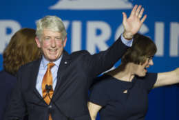 Democratic Attorney General Mark Herring and his wife Laura, right, celebrate his re-election with supporters at the Northam For Governor election night party at George Mason University in Fairfax, Va., Tuesday, Nov. 7, 2017. Herring won a second term as Virginia's attorney general Tuesday, beating back a challenge from Republican John Adams. (AP Photo/Cliff Owen)