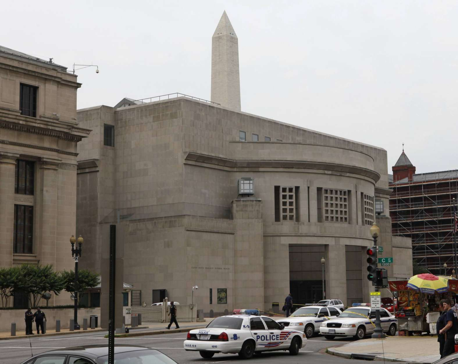 FILE – In this June 10, 2009, file photo, the Washington Monument looms over the U.S. Holocaust Memorial Museum, after a shooting that day that left a security officer dead and the gunman wounded in Washington. (AP Photo/Charles Dharapak, File)