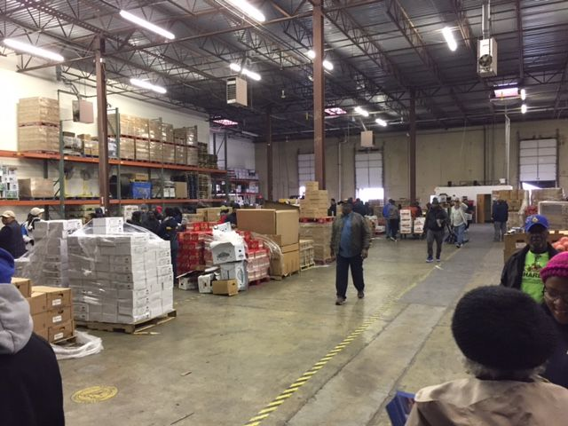 Over 386,000 pounds of food is being distributed to charity organizations, families and businesses that are trying to help make this Thanksgiving affordable for everyone. (WTOP/Dennis Foley)