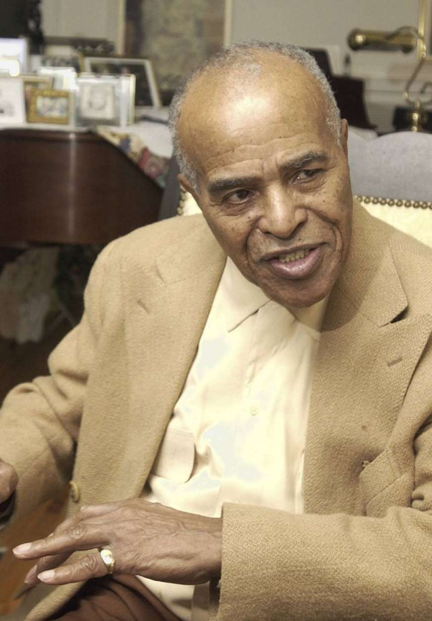 """FILE - In this Jan. 13, 2004 photo, Jazz singer Jon Hendricks talks about his career in jazz at his home in Toledo, Ohio, Hendricks, the pioneering jazz singer and lyricist who with the trio Lambert, Hendricks & Ross popularized the """"vocalese"""" singing style in which words were added to instrumental songs, died Wednesday, Nov. 22, 2017. He was 96. (AP Photo/Tony Dejak, File)"""