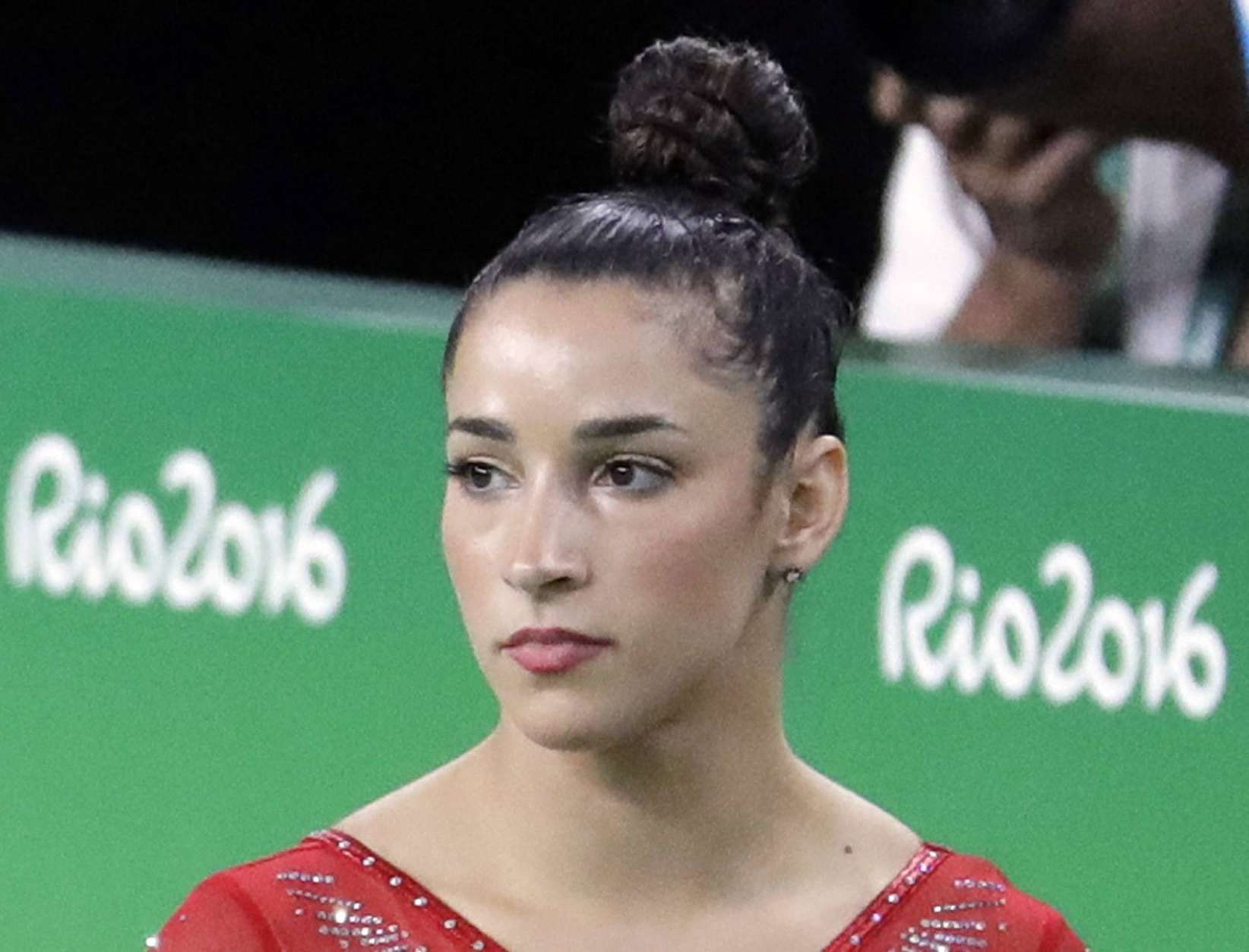 """FILE - In this Aug. 11, 2016, file photo, United States' Aly Raisman rests between apparatus' during the artistic gymnastics women's individual all-around final at the 2016 Summer Olympics in Rio de Janeiro, Brazil. Raisman says she is among the young women abused by a former USA Gymnastics team doctor. Raisman tells """"60 Minutes"""" she was 15 when she was first treated by Dr. Larry Nassar, who spent more than two decades working with athletes at USA Gymnastics. He's now is in jail in Michigan awaiting sentencing after pleading guilty to possession of child pornography. (AP Photo/Julio Cortez, File)"""