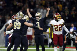 New Orleans Saints kicker Wil Lutz (3) celebrates his game winning field goal during overtime of an NFL football game against the Washington Redskins in New Orleans, Sunday, Nov. 19, 2017. The Saints won 34-31.(AP Photo/Butch Dill)