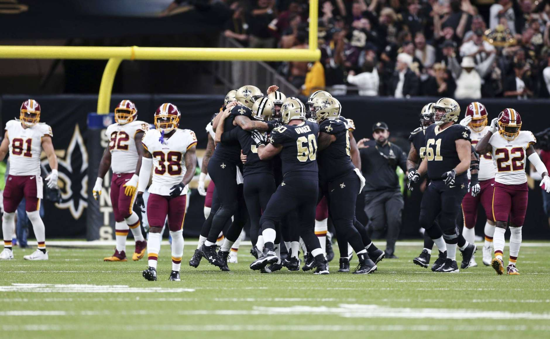 New Orleans Saints mob kicker Wil Lutz after he hit the game winning field goal during overtime of an NFL football game against the Washington Redskins in New Orleans, Sunday, Nov. 19, 2017. The Saints won 34-31.(AP Photo/Rusty Costanza)