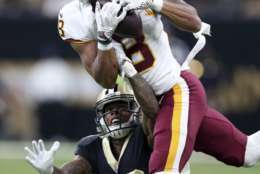 Washington Redskins wide receiver Josh Doctson (18) pulls in a pass in front of Washington Redskins cornerback Bashaud Breeland (26) in the first half of an NFL football game in New Orleans, Sunday, Nov. 19, 2017. (AP Photo/Rusty Costanza)