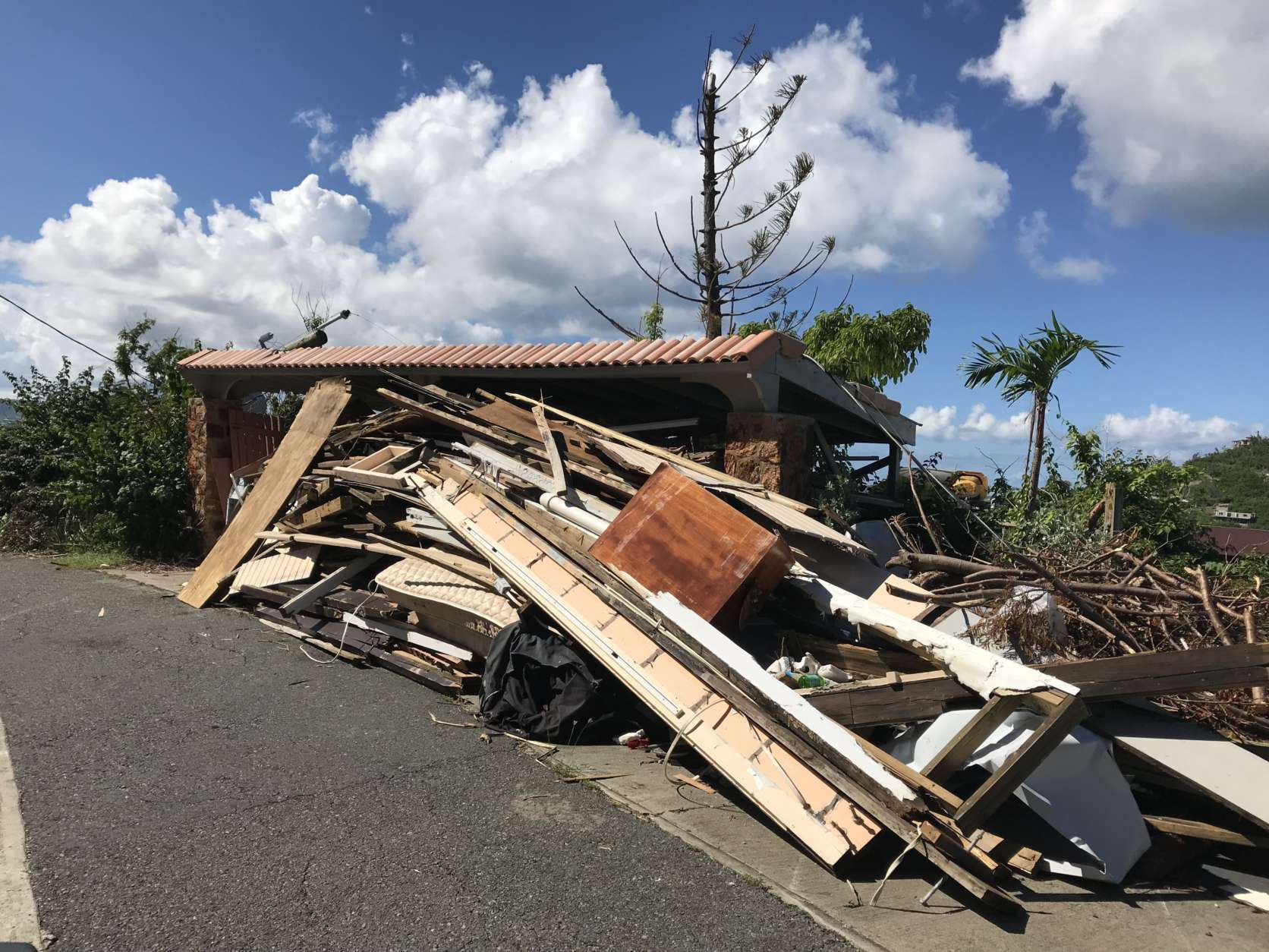 What remains of another Great Cruz Bay villa. Most damaged or destroyed homes were older wooden structures. (WTOP/Jeff Clabaugh)