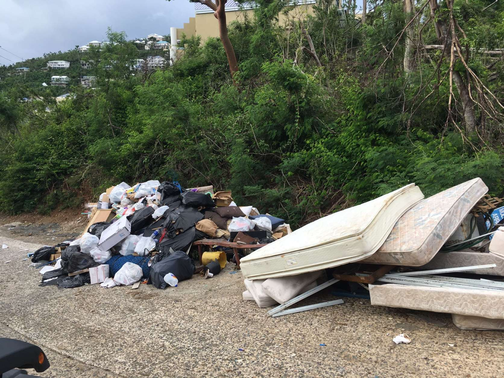 Debris management remains a struggle with public dumpsters overflowing. (WTOP/Jeff Clabaugh)