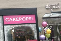 """""""We make everything from scratch, all of our cake pops, bagels, black and white cookies and everything else,"""" said owner Yael Krigman, a lawyer, who left a big D.C. law firm to start her bakery business several years ago, """"We've grown from one employee to almost three dozen employees. The vast majority are D.C. residents,"""" she said. (WTOP/Dick Uliano)"""