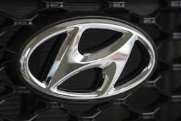 FILE - In this Oct. 26, 2017, file photo, the logo of Hyundai Motor Co. is seen on a car displayed at the automaker's showroom in Seoul, South Korea. Hyundai Motor Co. union spokesman Hong Jae-gwan said Tuesday, Nov. 28, 2017, that about 1,950 workers, or 4 percent of its union members, stopped work Monday at a plant in Ulsan, 380 kilometers (236 miles) southeast of Seoul. He said there was no plan to expand the partial strike into a full-blown one. (AP Photo/Lee Jin-man, File)