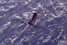 The Cygnus cargo spacecraft moves towards the International Space Station, Tuesday, Nov. 14, 2017, 260 miles (418 kms.) above the earth. The commercial supply ship arrived at the International Space Station on Tuesday, two days after launching from Virginia. (NASA TV via AP)