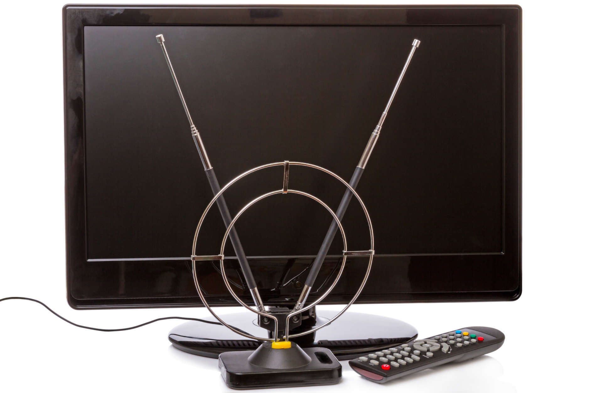 TV with remote control and indoor antenna isolated on a white background