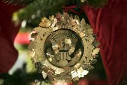 The First Family's official Christmas ornament is seen on a tree in the East Garden Room during a media preview of the 2017 holiday decorations at the White House in Washington, Monday, Nov. 27, 2017. (AP Photo/Carolyn Kaster)