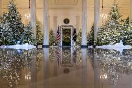 """The Grand Foyer and Cross Hall are decorated with """"The Nutcracker Suite"""" theme during a media preview of the 2017 holiday decorations at the White House in Washington, Monday, Nov. 27, 2017. (AP Photo/Carolyn Kaster)"""