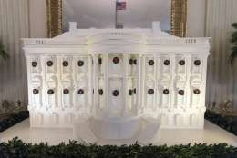 The gingerbread White House is seen in the East Dining Room during a media preview of the 2017 holiday decorations at the White House in Washington, Monday, Nov. 27, 2017. (AP Photo/Carolyn Kaster)