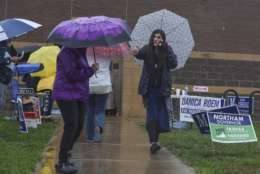 Danica Roem, right, who is running for house of delegates against GOP incumbent Robert Marshall, campaigns as voters take to the ballot boxes at Gainesville Middle School on Tuesday, Nov. 7, 2017, in Gainesville, Va. If Roem wins, she would be the first transgender legislator elected in the USA. (Jahi Chikwendiu /The Washington Post via AP)
