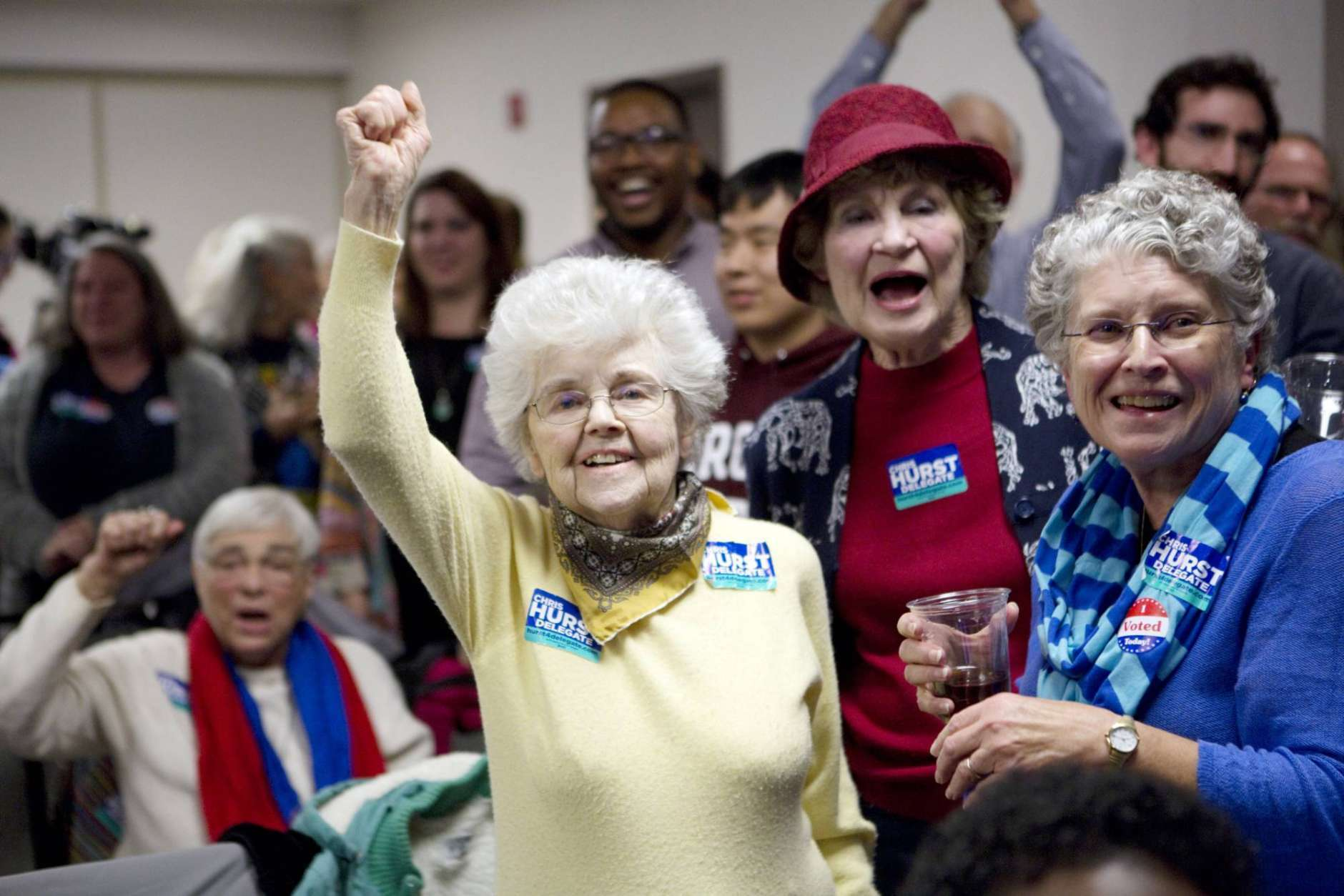 Julia Lewis, from left, Margaret Ray and Mary Banks celebrate when news breaks that Democrat Chris Hurst defeated Republican incumbent Joseph Yost to win House District 12 on Tuesday, Nov. 7, 2017, in Blacksburg, Va.  (Heather Rousseau/The Roanoke Times via AP)