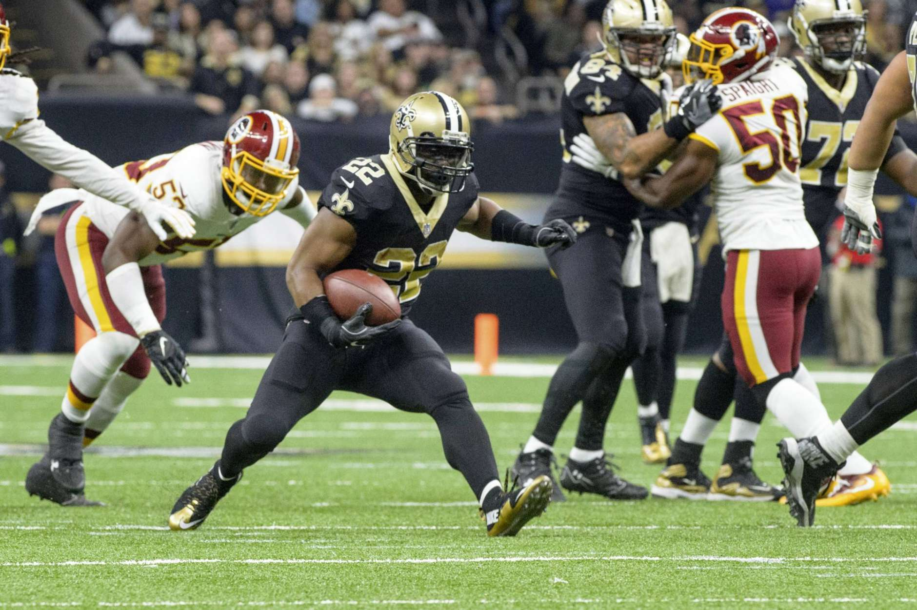 Saints running back Mark Ingram runs the ball as The New Orleans Saints take on The Washington Redskins during an NFL football game in the Mercedes-Benz Superdome, Sunday, Nov. 19, 2017 in New Orleans.   (Scott Clause/The Daily Advertiser via AP)