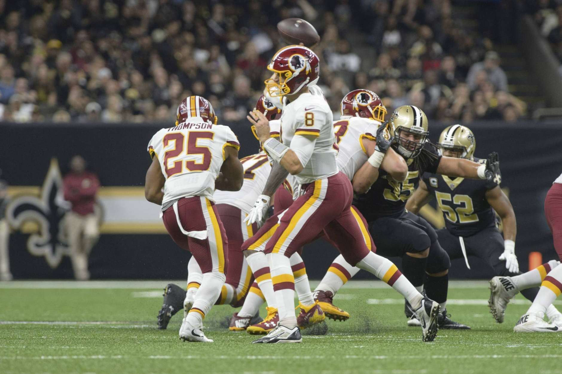 Redskins quarterback Kirk Cousins throws a pass as The New Orleans Saints take on The Washington Redskins during an NFL football game in the Mercedes-Benz Superdome, Sunday, Nov. 19, 2017 in New Orleans.   (Scott Clause/The Daily Advertiser via AP)