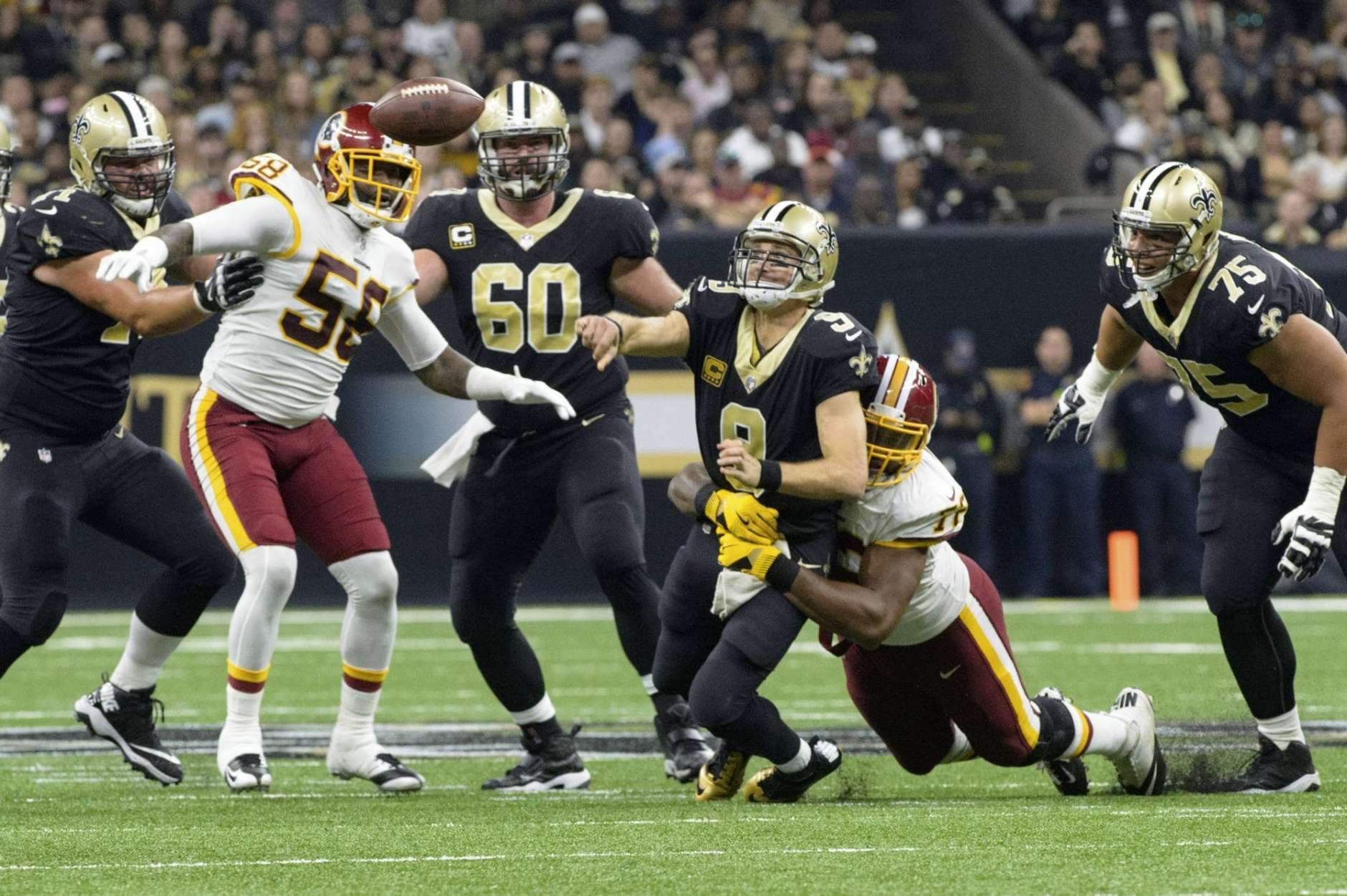Saints quarterback Drew Brees is hit as he throws a pass during an NFL football game as The New Orleans Saints take on The Washington Redskins in the Mercedes-Benz Superdome, Sunday, Nov. 19, 2017 in New Orleans.   (Scott Clause/The Daily Advertiser via AP)
