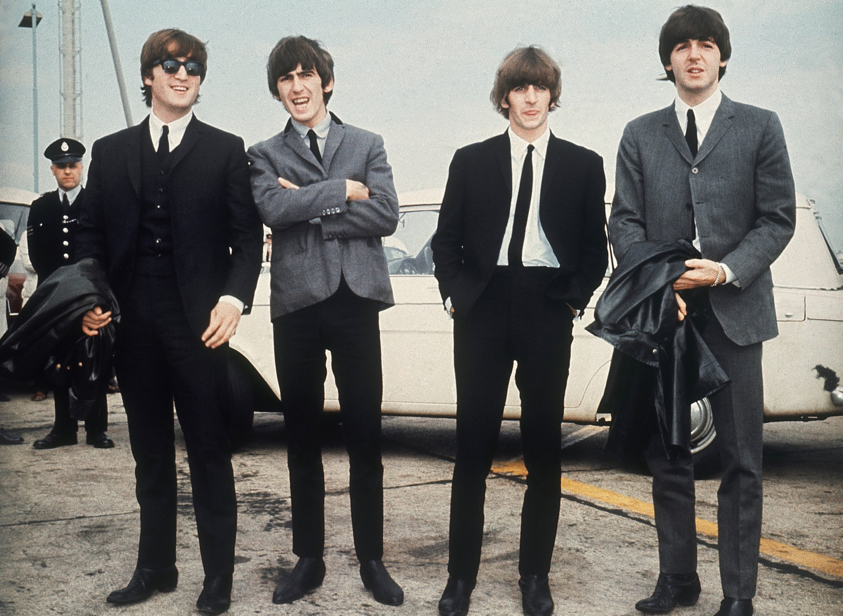 "The Beatles arrive at Speke airport, Liverpool on July 10, 1964, for the Liverpool premiere of their movie ""A Hard Day's Night."" From left: John Lennon, George Harrison, Ringo Starr and Paul McCartney. (AP Photo)"