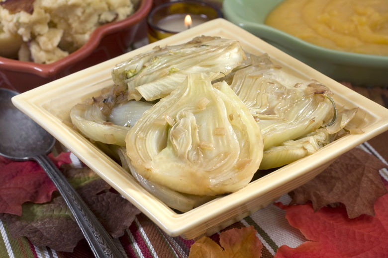This Oct. 12, 2010 photo shows braised fresh fennel with rosemary. The sweet flavor of fresh fennel becomes concentrated with luxurious results in this easy braised holiday side dish.    (AP Photo/Larry Crowe)