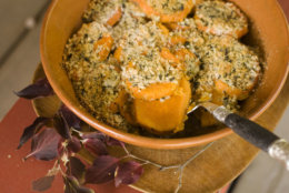 In this image taken on Oct. 8, 2012, herb-crusted sweet mashed potatoes are shown served in a bowl in Concord, N.H. (AP Photo/Matthew Mead)