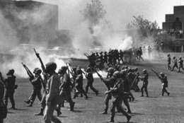 "FILE - In a May 4, 1970 file photo, Ohio National Guard moves in on rioting students at Kent State University in Kent, Ohio. Four persons were killed and eleven wounded when National Guardsmen opened fire. The U.S. Justice Department, citing ""insurmountable legal and evidentiary barriers,"" won't reopen its investigation into the deadly 1970 shootings by Ohio National Guardsmen during a Vietnam War protest at Kent State University. Assistant Attorney General Thomas Perez discussed the obstacles in a letter to Alan Canfora, a wounded student who requested that the investigation be reopened. The Justice Department said Tuesday, April 24, 2012 it would not comment beyond the letter.  (AP Photo, File)"