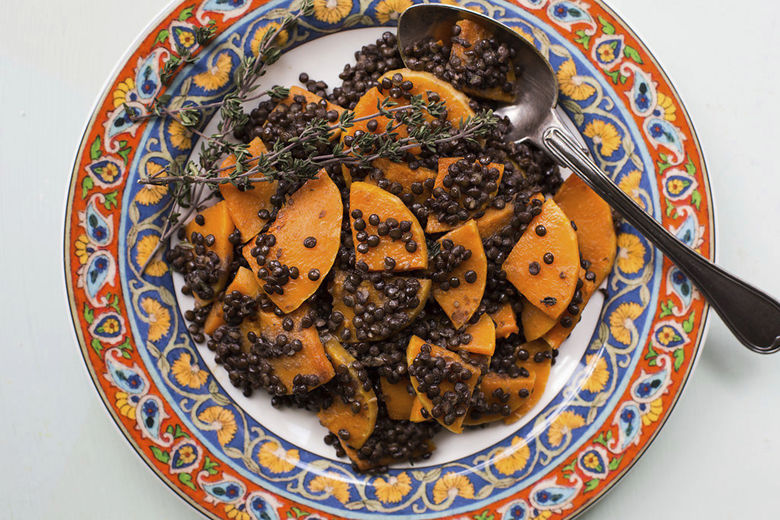 This February 2017 photo shows black lentil and butternut dquash in New York. This dish is from a recipe by Katie Workman. (Sarah Crowder via AP)