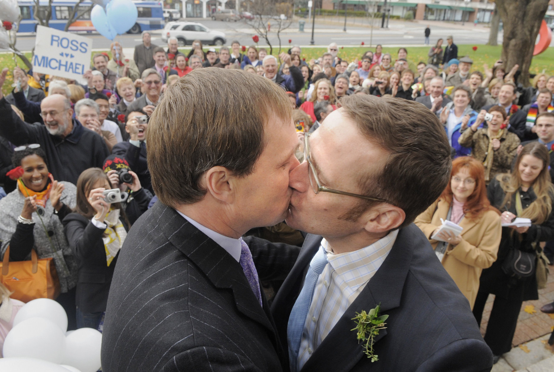 Michael Miller, left, and Ross Zachs, both of Hartford, share a kiss after being married in West Hartford, Conn., on Wednesday, Nov. 12, 2008. Miller and Zachs married on the day that a New Haven Superior Court Judge ruled that same sex marriages were legal in Connecticut.  (AP Photo/Fred Beckham)
