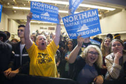 Supporters celebrate news that Democrat Ralph Northam has won the gubernatorial election, while partying at the Northam For Governor election night party at George Mason University in Fairfax, Va., Tuesday, Nov. 7, 2017. (AP Photo/Cliff Owen)
