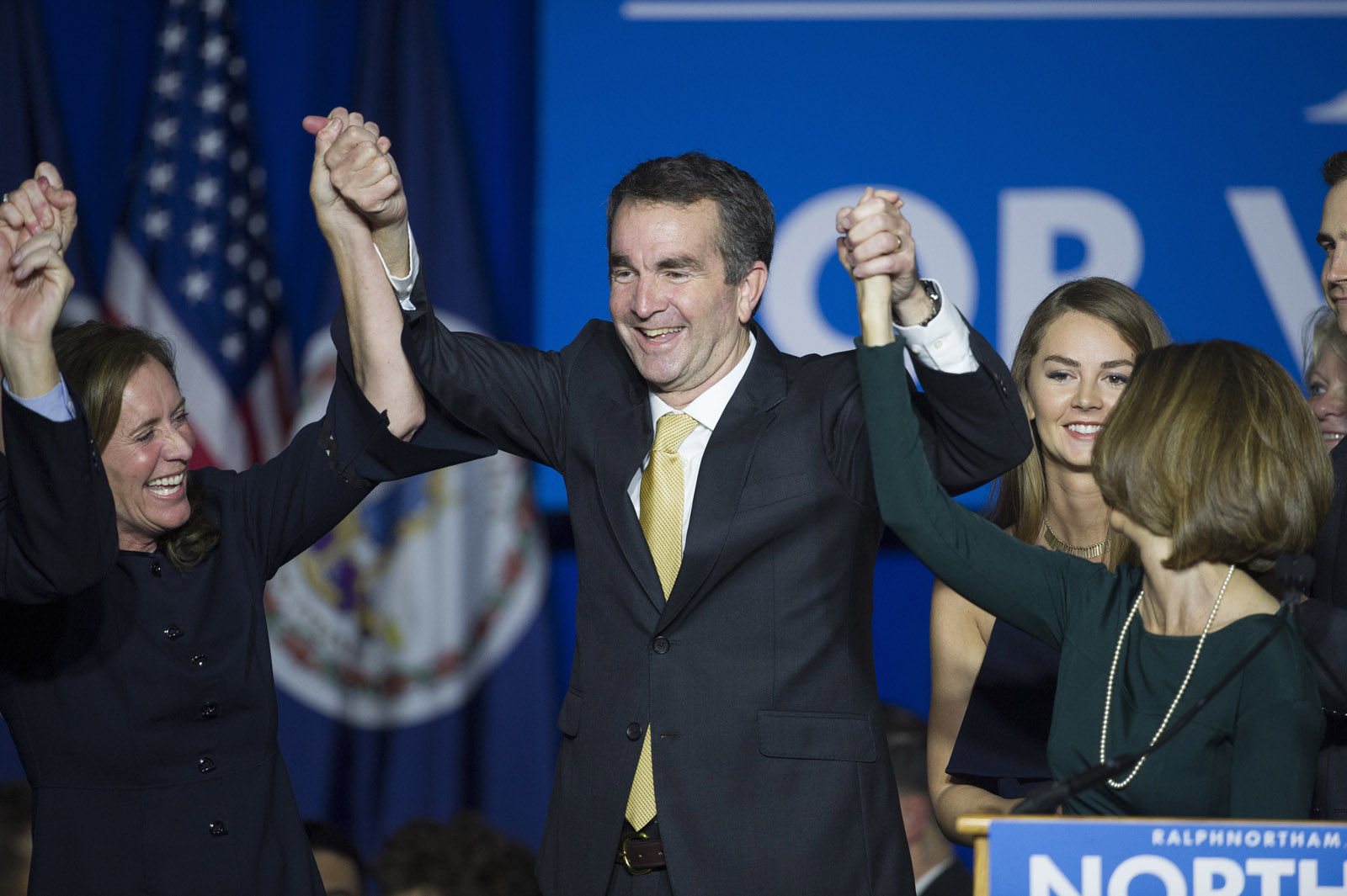 Virginia Gov.-elect Ralph Northam celebrates his election victory with his wife Pam and daughter Aubrey, right, and Dorothy McAuliffe, wife of Virginia Gov. Terry McAuliffe at the Northam For Governor election night party at George Mason University in Fairfax, Va., Tuesday, Nov. 7, 2017. (AP Photo/Cliff Owen)