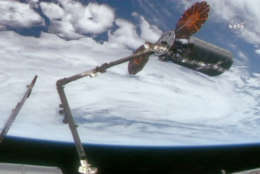The International Space Station's robotic arm captures the cargo on Tuesday after launching from Virginia. (Courtesy Ortbital ATK)