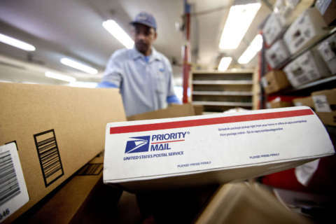 Postal Service plans Sunday delivery, still losing money