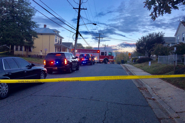 Photo shows police tape closing a road where there was a fire