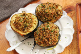 This Jan.11, 2016 photo shows an acorn squash stuffed with mushrooms, farro and winter citrus in Concord, N.H. This dish is from a recipe by Alison Ladman. (AP Photo/Matthew Mead)