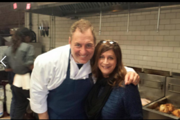 As Thanksgiving turkeys fry in the background, WTOP's Deborah Feinstein visits the kitchen with Medium Rare co-owner Mark Bucher on a previous Thanksgiving Day. (Courtesy Mark Bucher)