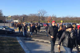 The weather was chilly but that didn't stop huge crowds from heading to Arlington National Cemetery to help out with the annual wreath laying Saturday. (WTOP/Nick Iannelli)