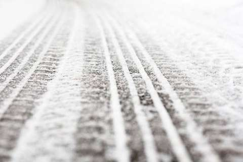 Snow, slick roads follow coldest day of the year