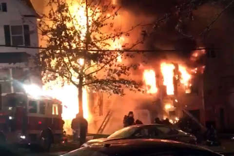 Flames engulf Southeast DC house, threaten nearby houses