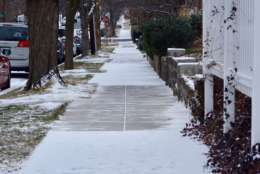 Snow checkers a sidewalk in D.C. Residents are required to shovel. (WTOP/Dave Dildine)
