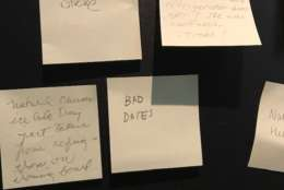 "So what happened in ""Kitchen Nutshell?"" Since the label doesn't explicitly say, the nearby post-its from visitors claim the woman in the diorama may have committed suicide or even ""ate too much bread and had a stroke."" (WTOP/Nahal Amouzadeh)"