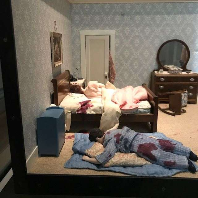 "In this photo: a focus on one bedroom in the diorama titled, ""Three-Room Dwelling."" (WTOP/Nahal Amouzadeh)"