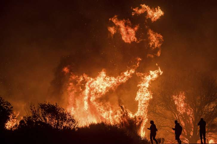 California Wildfires Continue to Spread, Closing Freeways and Destroying Homes