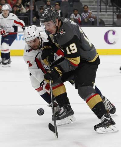 APTOPIX Capitals Golden Knights Hockey 80857 Vegas Golden Knights right  wing Reilly Smith (19) and Washington Capitals defenseman Matt Niskanen (2)  vie for ... 078f6ce89e6