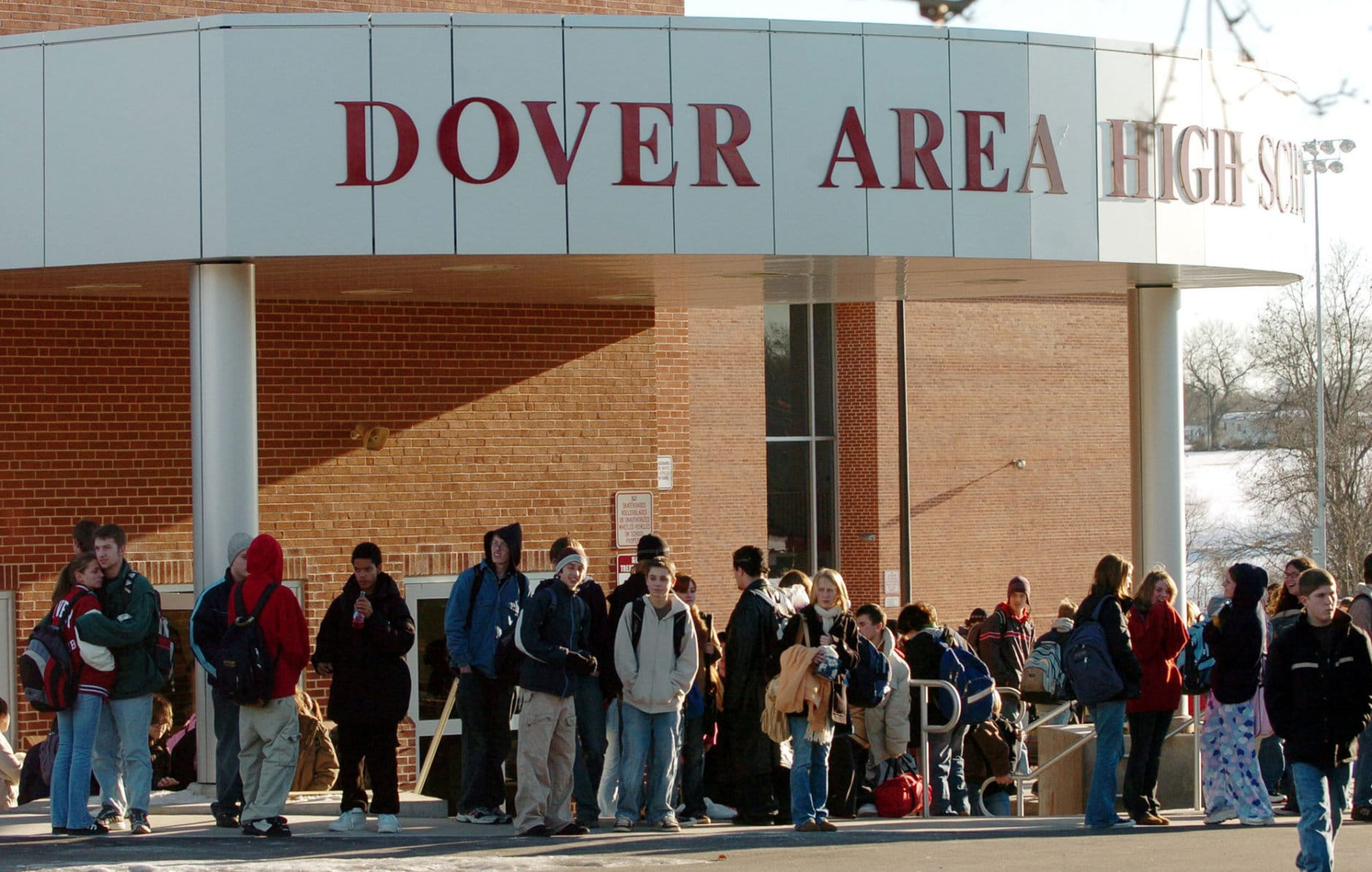 """FILE - Students head home after classes ended for the day at Dover Area High School Dec. 20, 2005 in Dover, Pa. This year, eight families upset over """"intelligent design"""" being offered as an alternative to evolution in their high school's biology curriculum ultimately prevailed in a legal challenge that emerged as a key battle in America's culture war. (AP Photo/Bradley C. Bower, file)"""