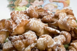 """A dish of fried ribbon cookies are seen in Concord, N.H. These cookies from Lidia Bastianich's cookbook """"Nonna Tell Me a Story,"""" are a Christmas tradition in her home and might become one in yours.   (AP Photo/Larry Crowe)"""