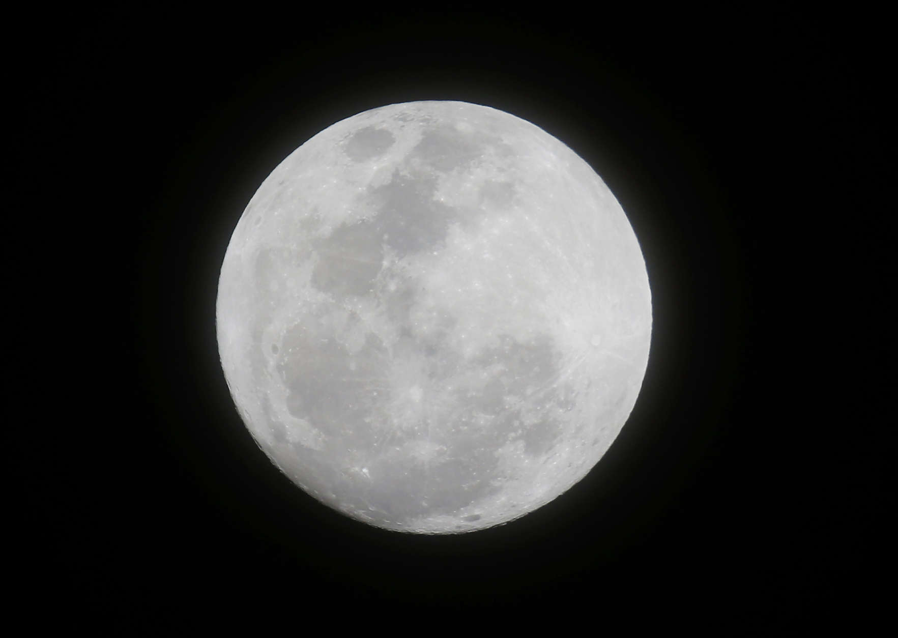 """The moon appears from the sky in the first supermoon of 2018 as seen from suburban Makati city east of Manila, Philippines on Monday, Jan. 1, 2018. Another """"Super Blood Blue Moon"""" is expected also later this month which according to scientists will coincide with a Total Lunar Eclipse. A """"supermoon"""" occurs when the moon appears bigger and brighter in the sky. (AP Photo/Bullit Marquez)"""