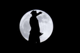 A bronze statue of General George Washington by William Rudolf O'Donovan stands on top of the Trenton Battle Monument while silhouetted by a supermoon, Monday, Jan. 1, 2018, in Trenton, N.J. The monument commemorates the victory at the first Battle of Trenton, which occurred on Dec. 26, 1776, and is located where the artillery dominated the streets of Trenton, preventing the Hessian troops from organizing attacks. Monday's moon is the second of three consecutive supermoons. The first occurred Dec. 3, 2017, and the next will happen on Jan. 31, 2018. (AP Photo/Julio Cortez)