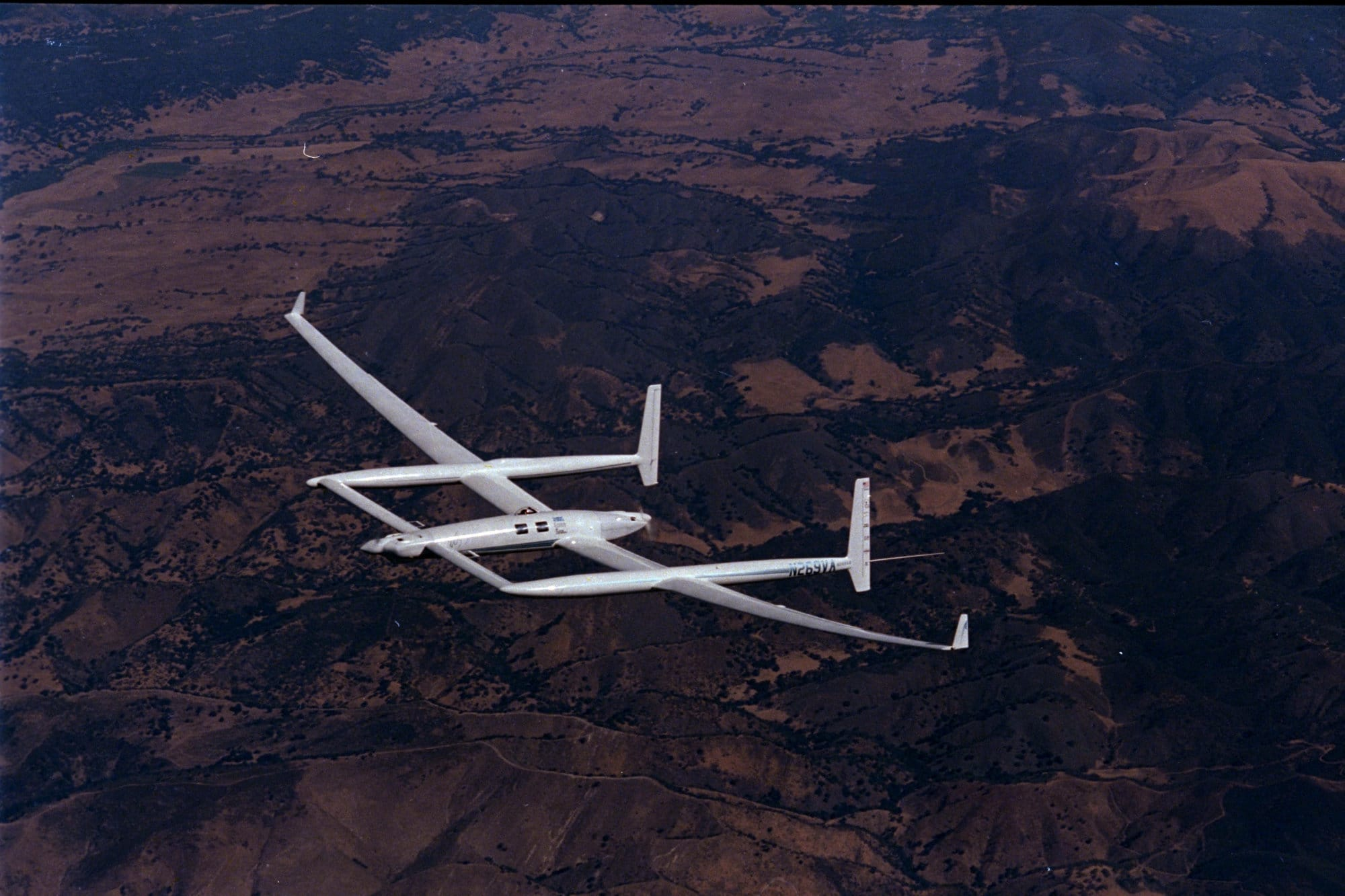 This is a December 5, 1986 photo of the twin-engine, pusher-puller experimental aircraft named Voyager during a training flight before her historic first non-stop, un-refueled flight around the world.  The plane took off from Edwards Air Force Base, Calif., Dec. 14, 1986 with 1,200 gallons of fuel onboard and returned to the desert base nine days later on Dec. 23 with 18 gallons to spare. (AP Photo/Douglas C. Pizac)